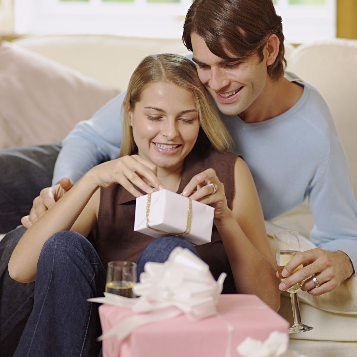 Newly married couple opening wedding gifts together