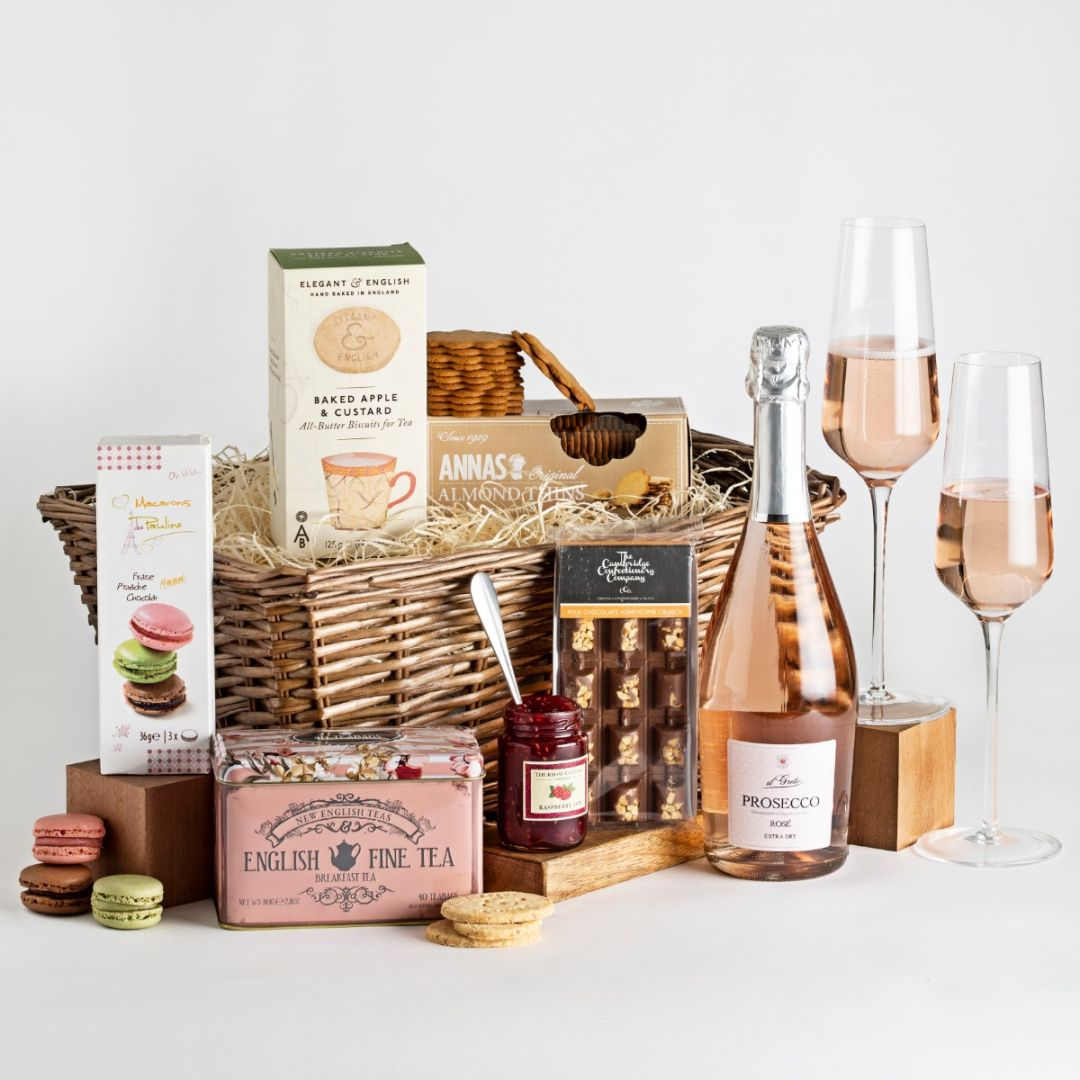 Couples sharing hamper with pink prosecco