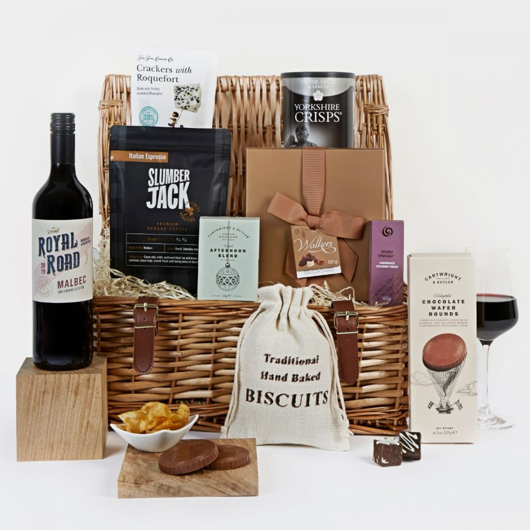 Image of classic food and drink hamper with basket and glass of red wine