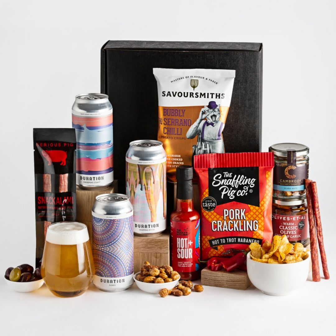 Craft beer and spicy snack hamper with snacks on display and a refreshing glass of beer