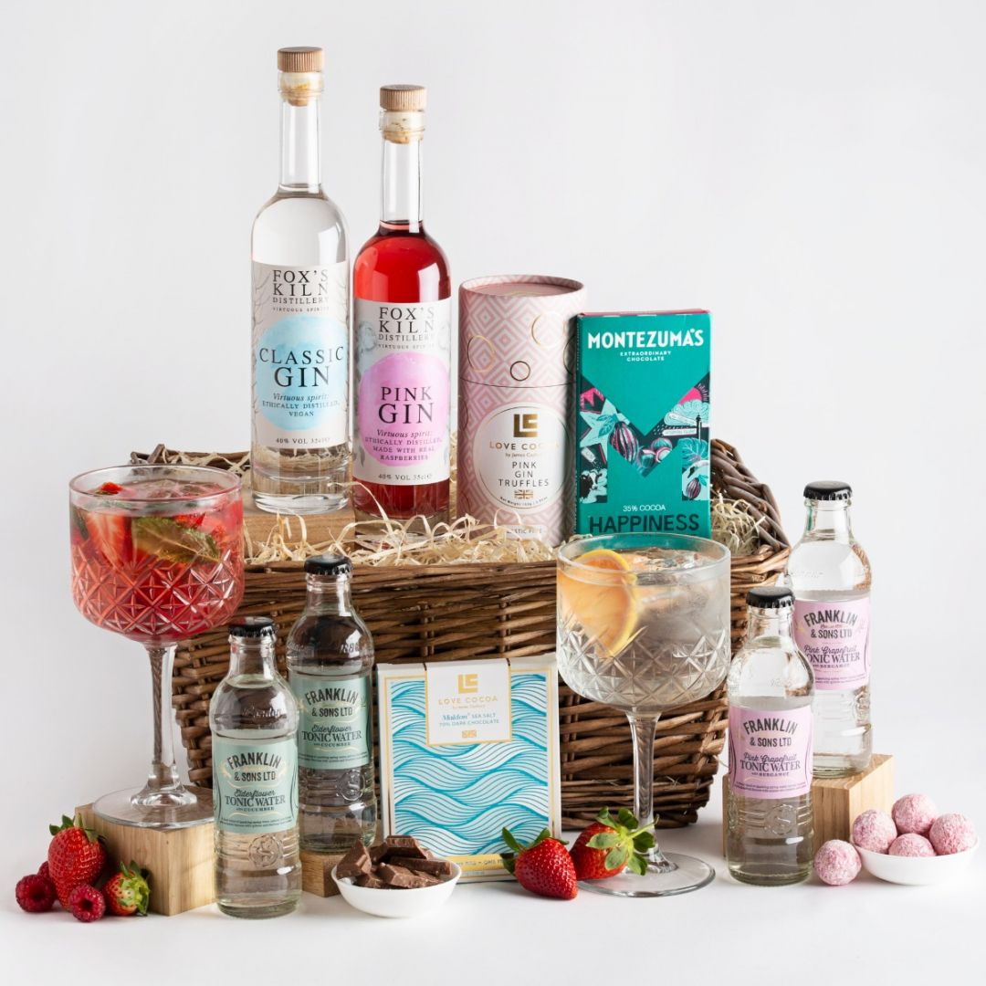 Fox's Kiln Gin and Treats Gift Basket with two glasses of gin, mixers and garnishes