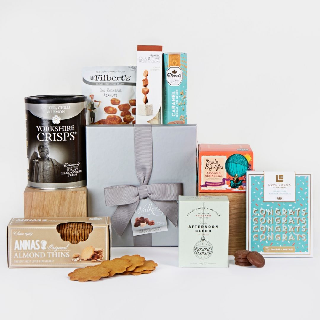 Congratulations hamper with chocolates and biscuits