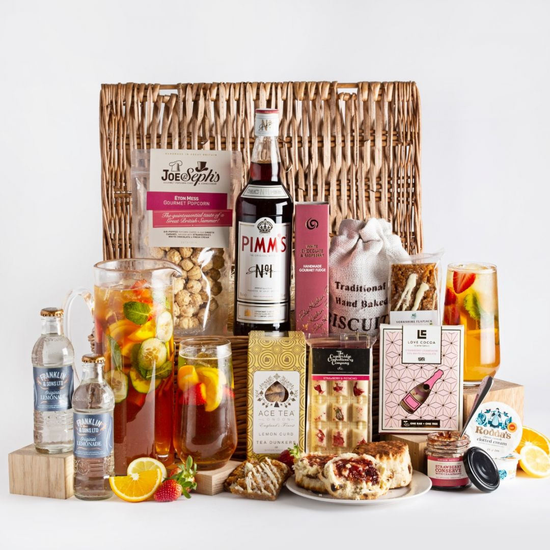 Pimms Sharing Hamper with all of the contents, a glass and a jug of Pimms, with a wicker basket