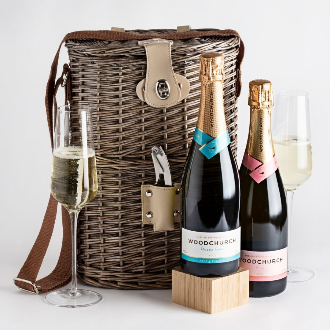 Two bottles of English sparkling wine traditional and rose with wicker carrier