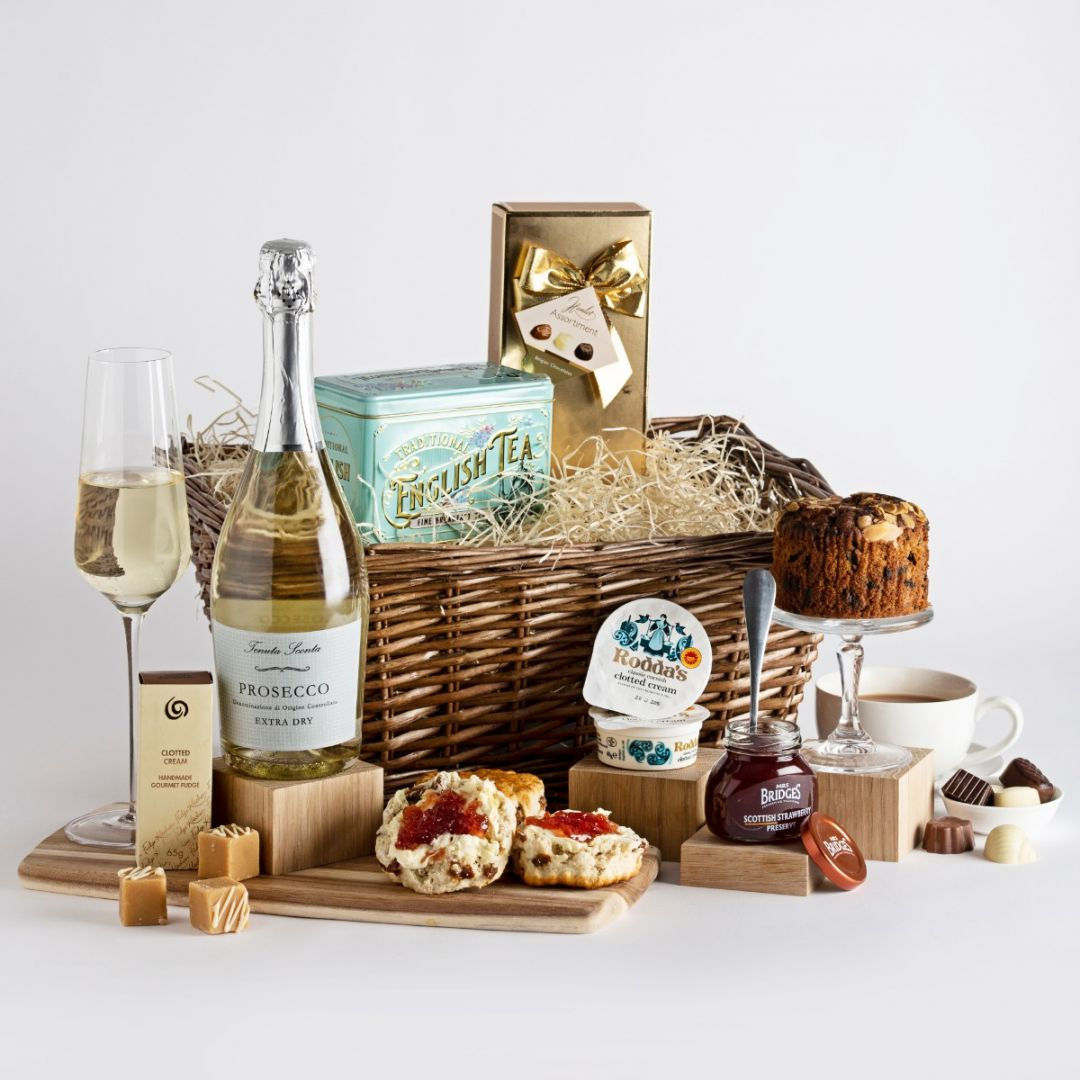Afternoon tea with prosecco hamper with cake, a mug of tea and a glass of prosecco