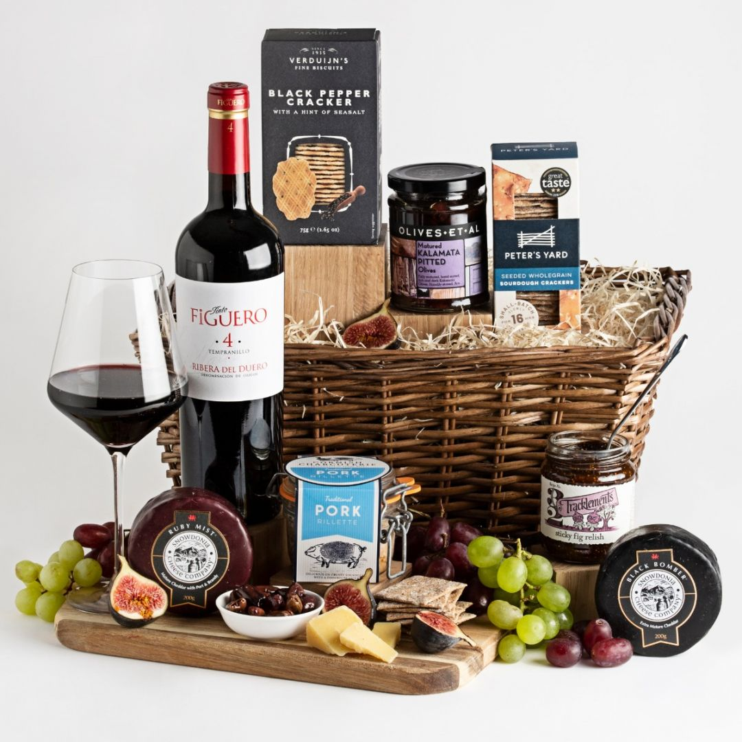 Luxury Wine, Cheese & Rillette Hamper with wicker basket and a glass full of red wine